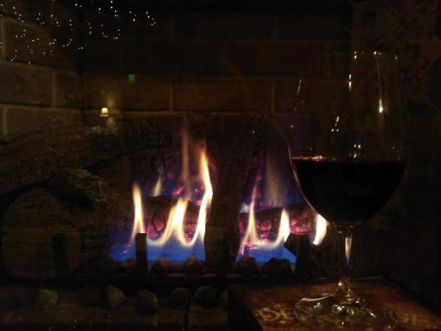 Enjoying a glass of wine by the fireplace