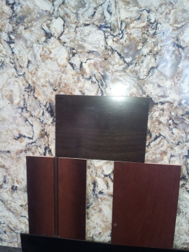 Testing the samples to see how the countertop will compliment the floors, trim and cabinetry.