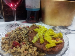 Bean Burger with hot sauce and banana peppers, served alongside a Quinoa-Veggie Stir-fry